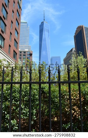 New York City, USA - May 3, 2015: Spring in bloom in Battery Park City near the newly opened World Trade Center Tower One at Ground Zero in New York City.  - stock photo