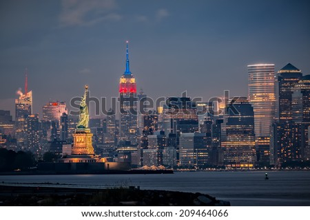 NEW YORK CITY, USA - MAY 27, 2014: Sunset over New York City skyline as Empire State Building is lit up for Memorial Day