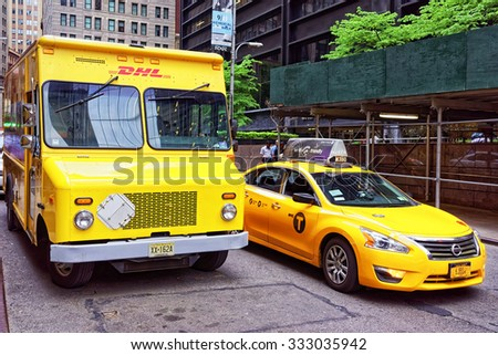 NEW YORK CITY, USA - MAY 6, 2015: Traditional yellow taxi car and a DHL van in Manhattan street. Yellow cars of taxi are a famous icon of New York City.                       - stock photo