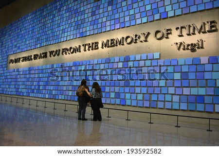 NEW YORK CITY, USA - May 17, 2014: Visitors in Memorial Hall in the National 9/11 Memorial Museum at Ground Zero in Lower Manhattan.  - stock photo