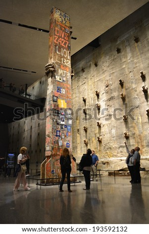 NEW YORK CITY, USA - May 17, 2014: Visitors viewing the Last Column and Slurry Wall in the National 9/11 Memorial Museum at Ground Zero in Lower Manhattan.  - stock photo