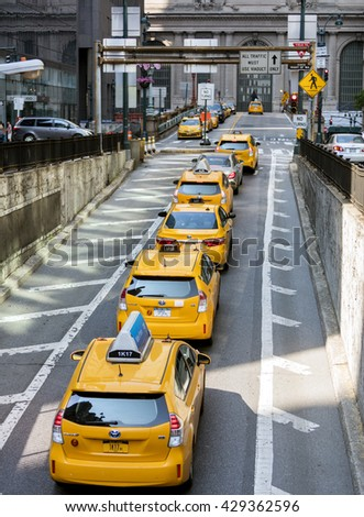 NEW YORK CITY, USA - May 28, 2016: Yellow taxi cabs in New York City wait outside Grand Central Terminal on Park Avenue for customers - stock photo