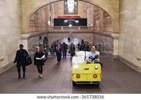 NEW YORK CITY, USA - NOV 17, 2015: A rail station worker drives a cargo utility vehicle through a tunnel at Grand Central Station. The station is one of the largest in the world covering 48 acres. - stock photo