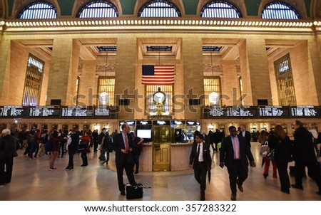 NEW YORK CITY, USA - NOV 12, 2015: Rail travelers pass through Grand Central Station. Opened in 1871 Grand Central is one of the largest train stations in the world covering 48 acres. - stock photo
