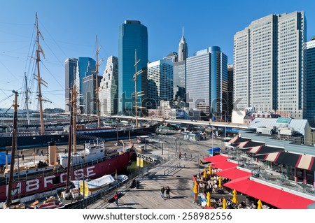 NEW YORK CITY, USA - NOVEMBER 18: People walk in Landmark seaport located next to Wall Street and financial center on a sunny day at November 18, 2011, NYC.  - stock photo