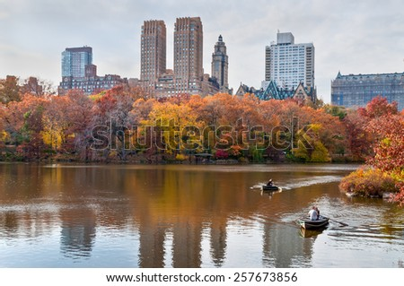 NEW YORK CITY, USA - NOVEMBER 14: Two couples can be seen in a row boat in Central Park in New York City, New York, USA at November 14, 2011.  - stock photo
