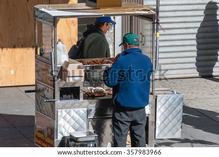 NEW YORK CITY, USA - Oct 26, 2008: Americas famous streetfood NYC situated on one of the world's largest natural harbors with five boroughs â?? Brooklyn, Queens, Manhattan, the Bronx, Staten Island - stock photo