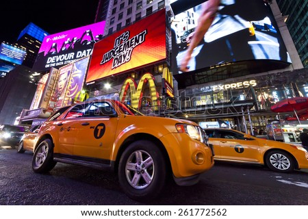 NEW YORK CITY, USA - OCT 4, 2014 : Times Square, featured with Broadway Theaters, Taxi Cabs and animated LED signs, is a symbol of New York City and the United States. - stock photo