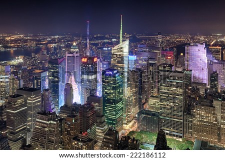 NEW YORK CITY, USA - OCTOBER 5: New York Uptown and Times Square on October 5, 2014, panorama aerial view at night with office building and skyscrapers skyline. - stock photo