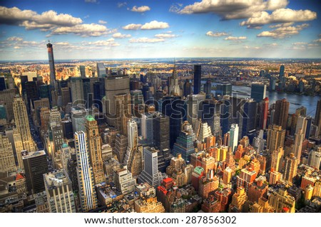 New York City, USA - October 8: The skyscrapers of New York City in HDR as viewed from the Empire State Building in Manhattan on the Fifth Avenue. October 8, 2014 in NYC, USA - stock photo