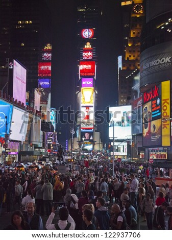 NEW YORK CITY, USA - SEPT 28: Times Square on September 28, 2012 , full of tourists from all the countries, featured with Theaters, and LED signs, is a symbol of New York City and the United States. - stock photo