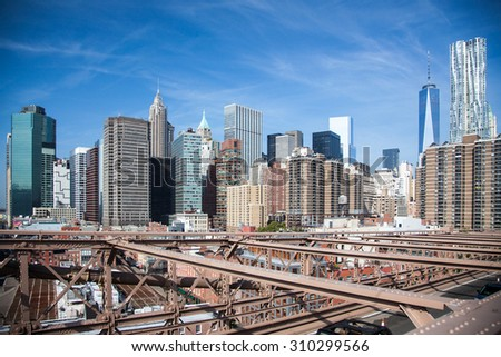 NEW YORK CITY, USA - SEPTEMBER, 2014: Downtown Manhattan seen from Brooklyn Bridge - stock photo