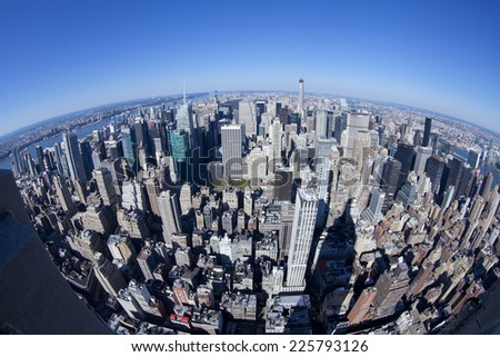 New York City, USA - September 27, 2014: High angle view of Manhattan in New York City during daytime. Shot from fisheye lens. - stock photo