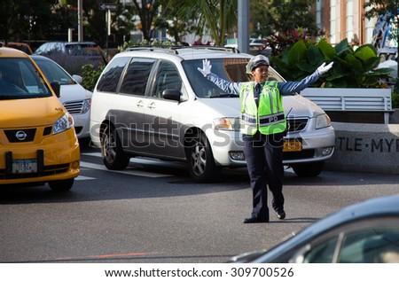 NEW YORK CITY, USA - SEPTEMBER, 2014: Traffic policewoman in New York City - stock photo
