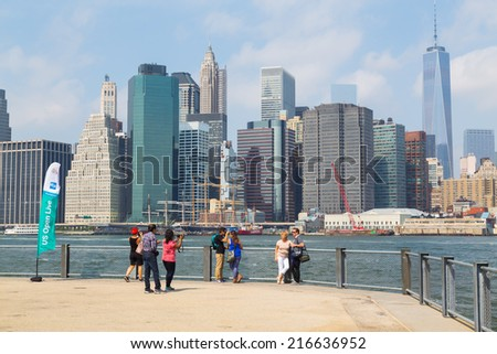 NEW YORK CITY, USA -  31ST AUGUST 2014: People taking pictures with the New York Skyline in the background - stock photo