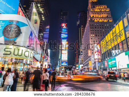 NEW YORK CITY, USA - 31ST AUGUST 2014: Time Square at Dusk showing taxis going past and billboards lit up