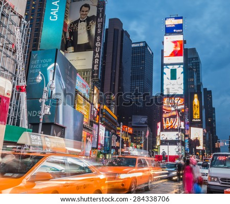 NEW YORK CITY, USA - 31ST AUGUST 2014: Time Square at Dusk showing taxis going past and billboards lit up - stock photo