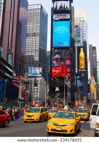 NEW YORK CITY, USA - 31ST AUGUST 2014: Time Square during the day showing large amounts of people and led billboards