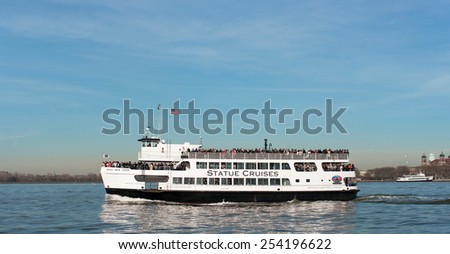 NEW YORK CITY, USA - 25TH NOVEMBER 2011: A Statue Cruises Tour Boat on Hudson river transporting a large amount of people heading toward the Statue of Liberty. - stock photo