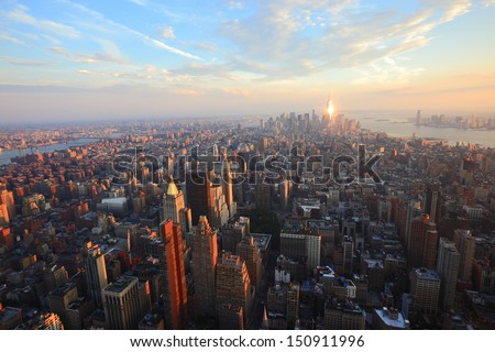 New York city view with one world trade center reflecting sunset  - stock photo