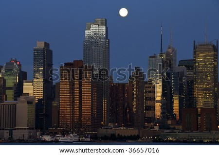 new york cityscape capture at night over hudson - stock photo