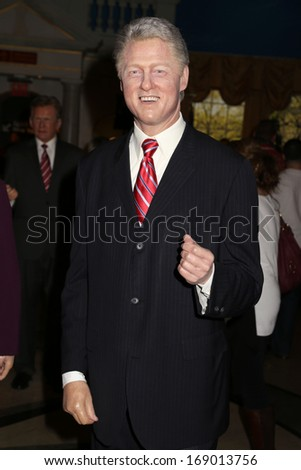NEW YORK - Dec 6: A wax figure of Bill Clinton is seen on display at Madame Tussauds on December 6, 2013 in New York City. - stock photo