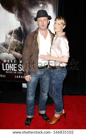 """NEW YORK-DEC 3: Actor Ben Foster (L) and Robin Wright attend the premiere of """"Lone Survivor"""" at the Ziegfeld Theatre on December 3, 2013 in New York City. - stock photo"""