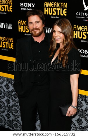 """NEW YORK-DEC 8: Actor Christian Bale and wife Sibi Blazic attend the """"American Hustle"""" premiere at the Ziegfeld Theatre on December 8, 2013 in New York City. - stock photo"""