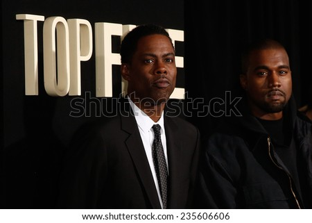 "NEW YORK-DEC 3: Comedian/actor Chris Rock and rapper Kanye West attend the ""Top Five"" premiere at the Ziegfeld Theatre on December 3, 2014 in New York City. - stock photo"