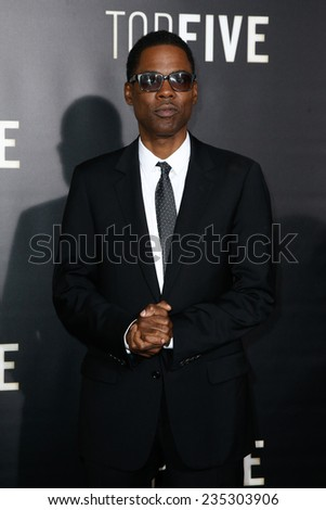 """NEW YORK-DEC 3: Comedian/actor Chris Rock attends the """"Top Five"""" premiere at the Ziegfeld Theatre on December 3, 2014 in New York City. - stock photo"""