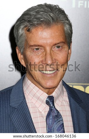 "NEW YORK - DEC 16: Michael Buffer attends the premiere of ""Grudge Match"" at the Ziegfeld Theater on December 16, 2013 in New York City."