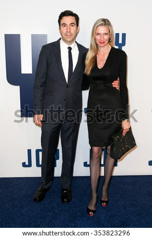 "NEW YORK-DEC 13: Model Catherine McCord (R) and producer Jonathan Gordon attend the ""Joy"" premiere at the Ziegfeld Theatre on December 13, 2015 in New York City."