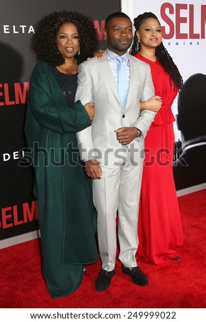 "NEW YORK - DEC 14, 2014: Oprah Winfrey, David Oyelowo and Ava DuVernay attend the premiere of ""Selma"" at the Ziegfeld Theatre on December 14, 2014 in New York City. - stock photo"