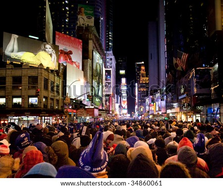 NEW YORK - DEC 31: Pedestrians gather in Times Square for New Year's Eve celebrations  on December 31, 2008 in New York City.