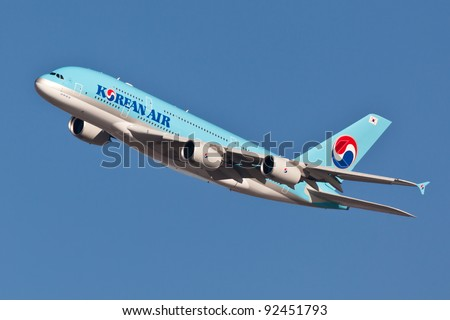 NEW YORK - DECEMBER 21:A380 Korean Air climbs after takeoff for JFK  in New York, USA on December 21, 2011Blue top livery was introduced on in 1984 A380 is the biggest passenger plane in the world - stock photo