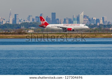 NEW YORK - DECEMBER 6: Airbus A320 Virgin landing on JFK Airport in New York on December 6, 2012. JFK Is rated 4th biggest American Airport, Call sign used by Virgin America is Redwood
