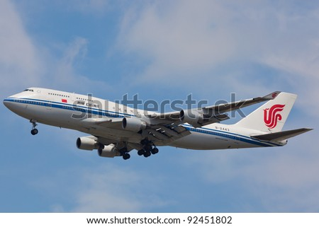 NEW YORK - DECEMBER 21:B747 China Air on final approach to JFK airport in New York on December 21, 2011 Air China is is flag carrier of People's Republic of China and world's 10th largest airline - stock photo