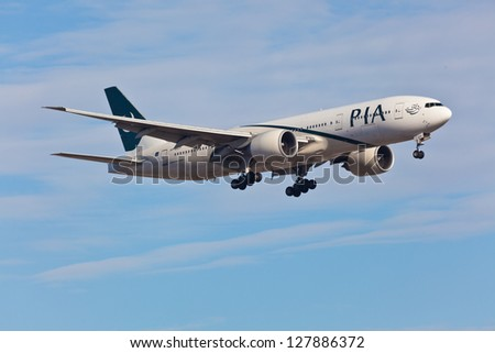 NEW YORK - DECEMBER 9: Boeing 767 Pakistan International Airlines on final approach to JFK Airport located in New York, USA on December 9, 2012 PIA is the national flag carrier of Pakistan - stock photo