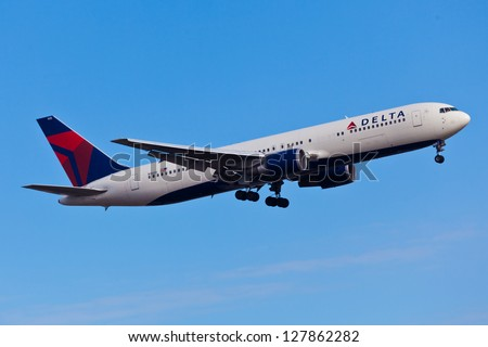 NEW YORK - DECEMBER 9: Delta Boeing 737 climbs after take off from JFK in New York USA on DECEMBER 9 2012 Delta is one of the biggest airlines in the world serve over 300 destinations around the world