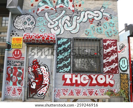 NEW YORK - DECEMBER 4, 2014: Mural art at East Williamsburg in Brooklyn. Outdoor art gallery known as the Bushwick Collective has most diverse collection of street art in Brooklyn