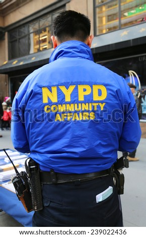 NEW YORK - DECEMBER 18: NYPD community affairs officer in Manhattan on December 18, 2014. New York Police Department, established in 1845, is the largest police force in USA - stock photo
