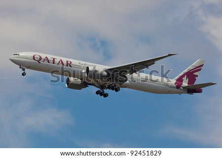 """NEW YORK - DECEMBER 21: Qatar Boeing 767 on final to JFK in New York, USA on December 6, 2011. Qatart is rated top 3 best airlines in the world also rated the as a """"best food in flight"""" in the world - stock photo"""
