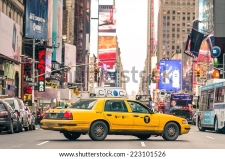 NEW YORK - DECEMBER 22, 2013: rush hour with yellow cab on 7th av. in Manhattan before sunset. Seventh Avenue is southbound below Central Park and a two-way street north of the park. - stock photo