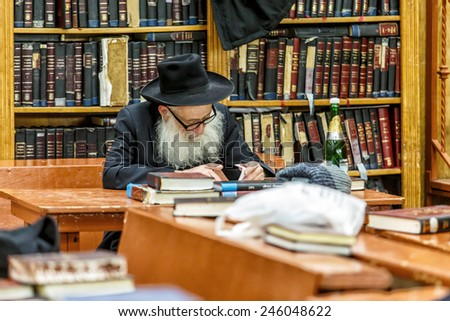 NEW YORK - DECEMBER 26: Ultra Orthodox Jewish man studying scriptures in the famous 770 Chabad Lubavitch headquarter and home to last Chabad leader Menachem Mendel Schneerson on December 26 2014 - stock photo