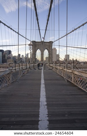 NEW YORK - DECEMBER 12:  Vertical wide angle view of the Brooklyn Bridge with tourists and regular pedestrians.