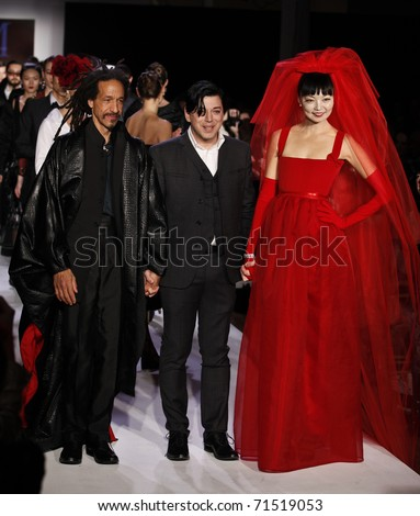 NEW YORK - FEB 17: Irina Pantaeva, Baron Leandro, Malan Breton walk the runway for collection by Malan Breton at Mercedes-Benz Fall/Winter 2011 Fashion Week in Metropolitan Pavilion on Feb 17, 2011 in NYC