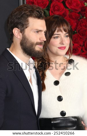 "NEW YORK - FEB 5, 2015: Jamie Dornan and Dakota Johnson attend a screening of ""Fifty Shades of Grey"" at the Ziegfeld Theatre on February 5, 2015 in New York.  - stock photo"