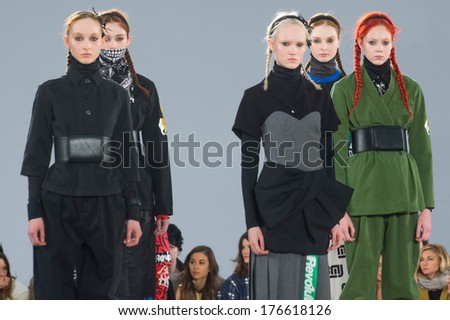 NEW YORK-FEB 13: Models pose on the runway at the Marc Jacobs fashion show during Mercedes-Benz Fashion Week Fall 2014 at Lexington Avenue Armory on February 13, 2014 in New York City. - stock photo