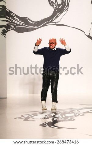 NEW YORK - FEBRUARY 16: A designer Lie Sangbong walks the runway at the Lie Sangbong Fall/Winter 2015 collection during Mercedes-Benz Fashion Week in New York on February 16, 2015. - stock photo