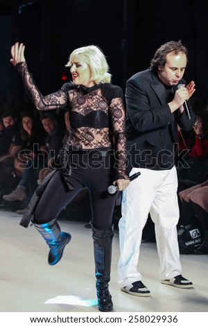 NEW YORK - FEBRUARY 13: A designer Mark Tango and Estel Day walks the runway at the Mark & Estel Fall/Winter 2015 collection during Mercedes-Benz Fashion Week in New York on February 13, 2015. - stock photo